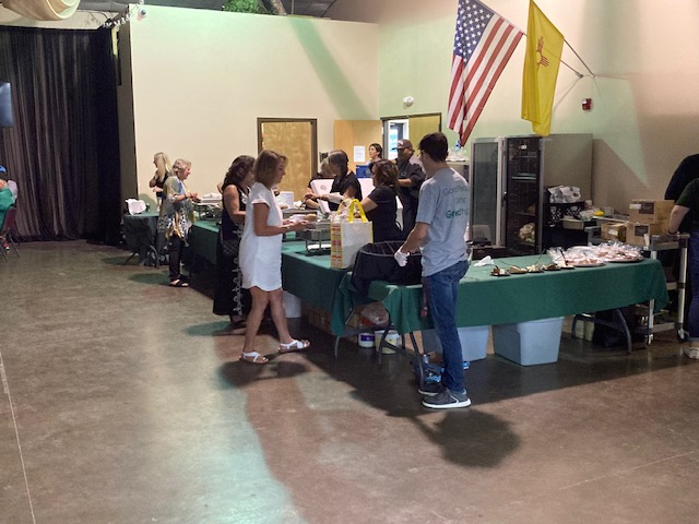 Students serving and bussing tables at the tournament dinner